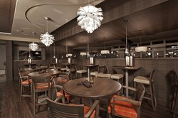 Grill 55 - Tables and seating by the bar