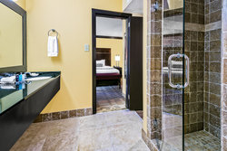 King Executive Suite Guest Bathroom with glass walk-in shower