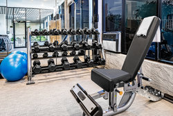 Stay healthy while visiting Houston at our fully equipped gym.