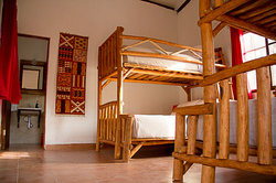 Quad Room with two bunk beds, each offering a full bed below and twin bed on top.