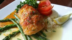 Stuffed Filet Sole with lump crab meat and shrimp over jasmine rice  served with seasonal vegetables