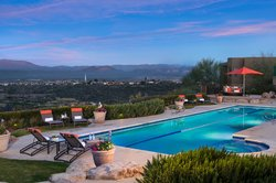 Lap pool perched on mountainside.