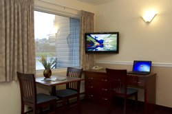 Guest Room Suite With TV & Table