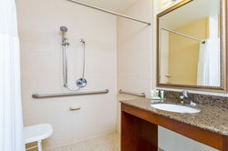Up-to-Date ADA Guest Bathroom equipped with Roll-In Shower