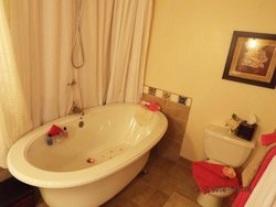 Ensuite with deluxe jacuzzi and shower.