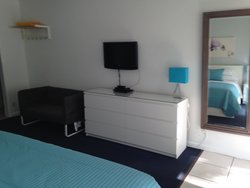 Suite with King Bed - Dresser & TV