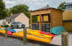 Dockside Boat Rentals will deliver kayaks & bikes to Sandaway. Also, can rent directly from them a half block away.