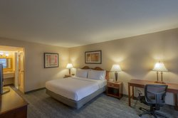 Guest suite features a spacious living area and wet bar