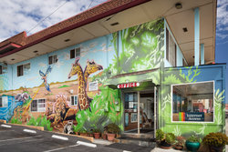 Stay at our Santa Cruz hotel with vibrant exterior mural!