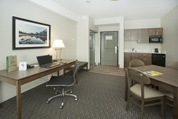 King Suite Work Desk And Dining Area