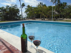 Enjoy a glass of wine by the pool