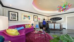 Stylish Front Lobby with Signature Raspberry Couch