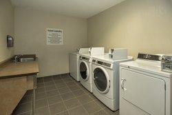 Coin operated guest laundry facility for your convenience