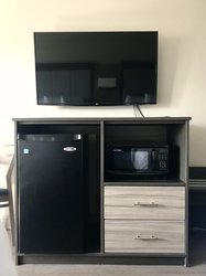"Dresser with 50"" TV, complimentary microwave and refrigerator"