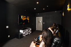 Studio Z Game Lounge with guests viewing a movie