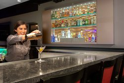 12 Sixty Bar Pouring Drinks