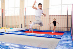 Family Jumping In Trampoline Park