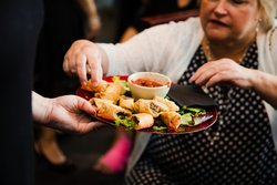 Food Buttlered Spring Rolls With Wedding Guest
