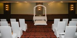 Wedding Ceremony Archway And Chairs
