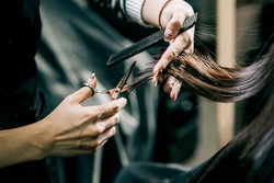 Hands With Scissors Cutting Girls Hair