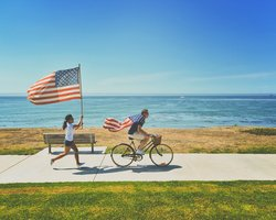 America, kids on bikes with flag
