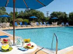 Outdoor Pool with Loungers and Fruit