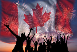 People Celebrating With Canadian Flag In Background
