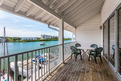 Search for dolphins on your balcony in a Marina View King Loft.