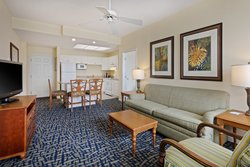 Our 2 Queen Suites offer full kitchens and a living area.