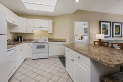 Kitchen in the 2 Queen Suite has full sized appliances and island.