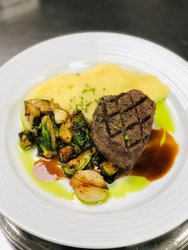 Center Cut Angus Reserve Filet Mignon With Port Wine Demi, Chive Whipped Potatoes, And Crispy Brussel Sprouts With Balsamic And