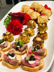 Wedding Party Hors D' Oeuvres Including Beef Tenderloin Crostini With Balsamic Onions And Horseradish Crème, Maryland Crab Cakes
