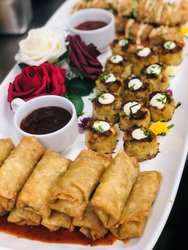 Wedding Party Hors D' Oeuvres Including Vegetable Egg Rolls, Maryland Crab Cakes With Lemon Aioli, Sesame Chicken Tempura Bites
