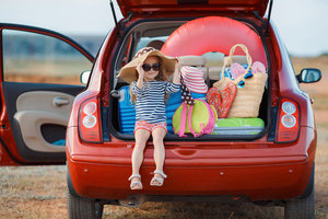 Girl Sitting In Car At Beach Vacation