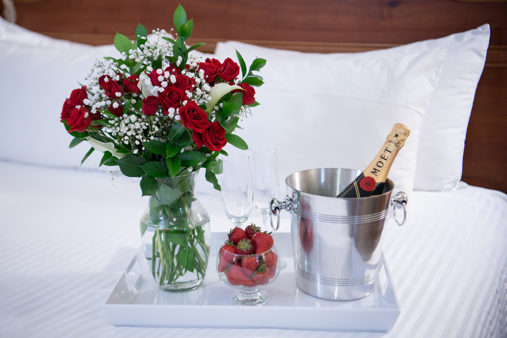 Roses And Champagne On Bed Special