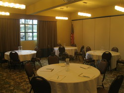 Meeting Room with Ballroom Tables and Notepads