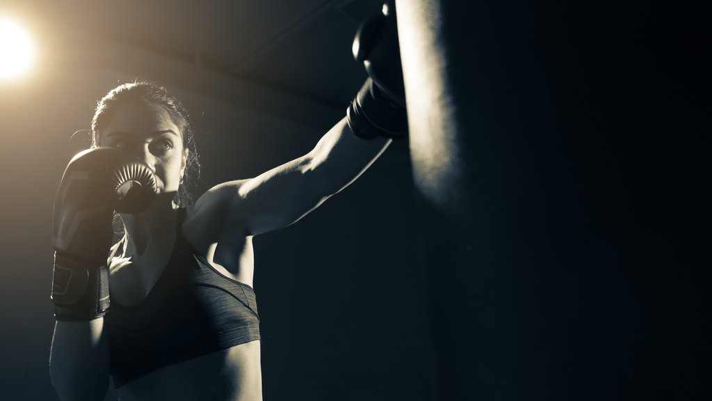 Woman Boxing Training At Gym