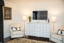 1 Dresser With Two Chairs In Suite